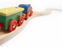 Colorful wooden toy train detail isolated on white. Horizontal stock images