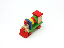 Colorful wooden toy train. Image of a colorful wooden toy train set in a nearly isometric viewpoint Royalty Free Stock Photo