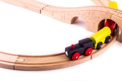 Colorful wooden toy train on a wood rail stock photo