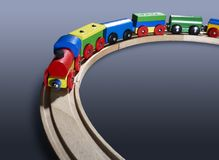 Colorful wooden toy train on tracks Royalty Free Stock Photo