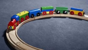 Colorful wooden toy train on tracks Stock Photo