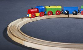 Colorful wooden toy train on tracks Royalty Free Stock Image