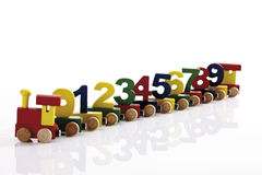 Colorful wooden toy train with wooden figures Royalty Free Stock Photo