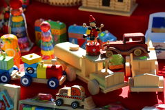 Colorful wooden toys. Different cars and figurines Stock Photos