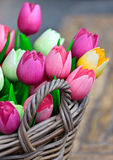 Colorful wooden tulips in a basket Stock Images