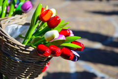 Colorful wooden tulips in basket Stock Image