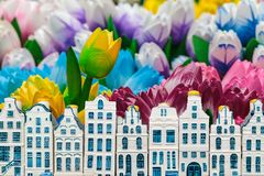 Wooden tulips with small souvenir Amsterdam canal houses. Colorful wooden tulips with small souvenir Amsterdam canal houses in front Stock Photography