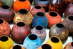 Colorful wooden vases. Colorful crafted vases on a table Royalty Free Stock Photo