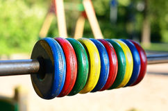 Colorful wooden wheels at children playground. Selective focus Royalty Free Stock Images