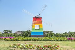 Colorful wooden windmill in public park. On blue sky background Royalty Free Stock Image