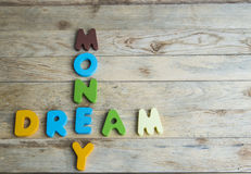 Colorful wooden word Dream and Money on wooden floor1 Stock Images