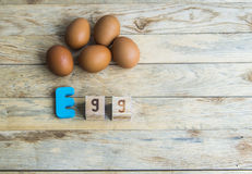 Colorful wooden word Egg on wooden floor2 Stock Images
