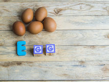 Colorful wooden word Egg on wooden floor1 Royalty Free Stock Image