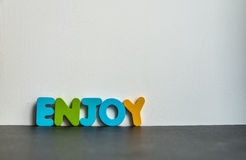 Colorful wooden word Enjoy with white background1 Stock Image