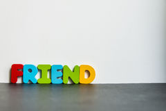 Colorful wooden word Friend with white background1 Royalty Free Stock Images