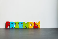Colorful wooden word Friendly with white background1 Stock Photo