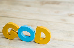 Colorful wooden word God on wooden floor5 Royalty Free Stock Photo