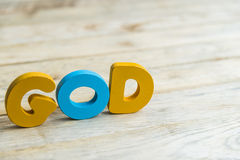Colorful wooden word God on wooden floor3 Royalty Free Stock Photos