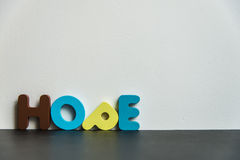 Colorful wooden word hope with white background1 Stock Photography