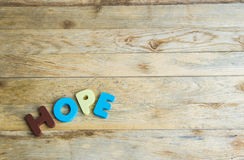 Colorful wooden word Hope on wooden floor1 Stock Image