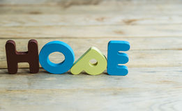 Colorful wooden word Hope on wooden floor5 Royalty Free Stock Photo