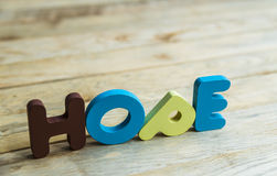 Colorful wooden word Hope on wooden floor3 Stock Images
