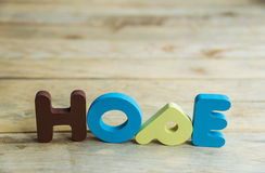 Colorful wooden word Hope on wooden floor2 Royalty Free Stock Photo