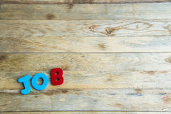 Colorful wooden word Job on wooden floor2 Royalty Free Stock Photo