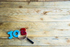 Colorful wooden word Job on wooden floor1 Royalty Free Stock Photography