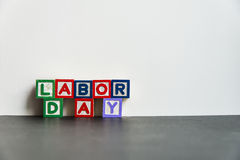Colorful wooden word Labor day with white background3 Stock Image