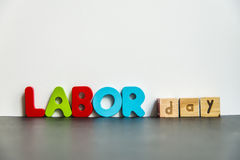 Colorful wooden word Labor day with white background2 Stock Photo