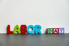 Colorful wooden word Labor day with white background1 Royalty Free Stock Photos