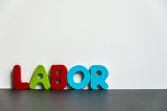 Colorful wooden word Labor with white background1 Stock Images