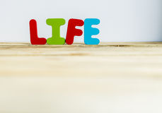 Colorful wooden word Life with white background5 Stock Images