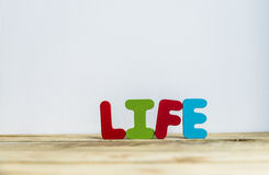 Colorful wooden word Life with white background3 Stock Photos