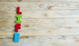 Colorful wooden word Life on wooden floor2 stock photo