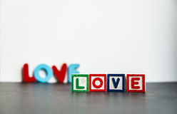 Colorful wooden word Love with white background2 Royalty Free Stock Images
