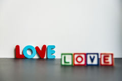 Colorful wooden word Love with white background4 Stock Photography
