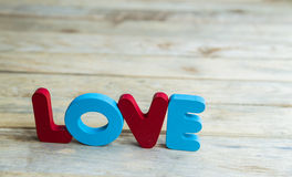 Colorful wooden word Love on wooden floor4 Stock Photos