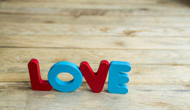 Colorful wooden word Love on woodne floor7 Stock Images