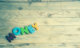 Colorful wooden word Money on wooden floor2 Royalty Free Stock Images