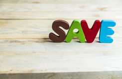 Colorful wooden word Save on wooden floor7 Royalty Free Stock Image