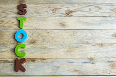 Colorful wooden word Stock on wooden floor4 Stock Photos