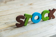 Colorful wooden word Stock on wooden floor9 Royalty Free Stock Photography