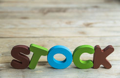 Colorful wooden word Stock on wooden floor6 Royalty Free Stock Images