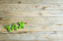 Colorful wooden word Tax on wooden floor1 Stock Images