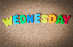 Colorful wooden word WEDNESDAY on Cork board with selective focus. 1 stock images