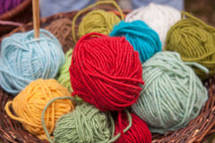 Colorful wool balls in basket Royalty Free Stock Image