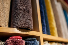 Colorful wool carpets in stores  assortment. Colorful wool carpets in stores Royalty Free Stock Images