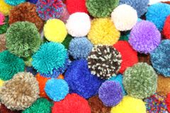 Colorful wool pompoms. For making and decorating jewelery and fabrics Stock Images